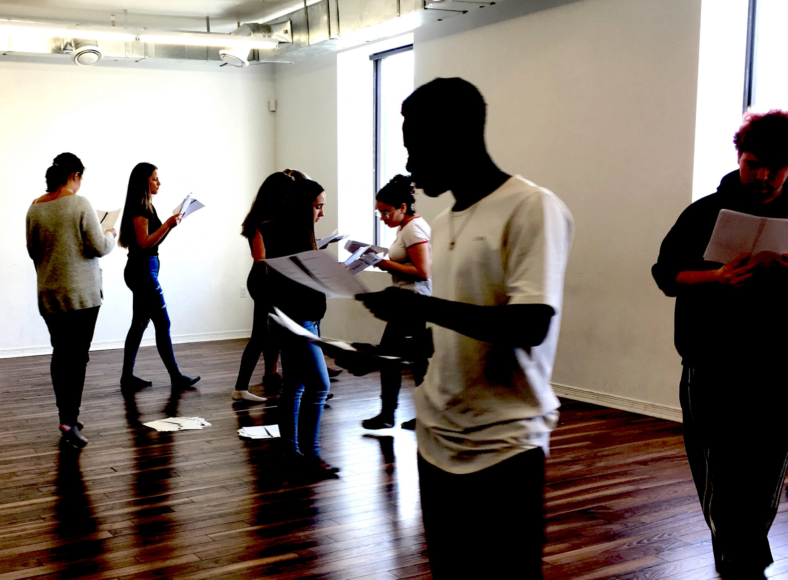 students moving around a rehearsal studio